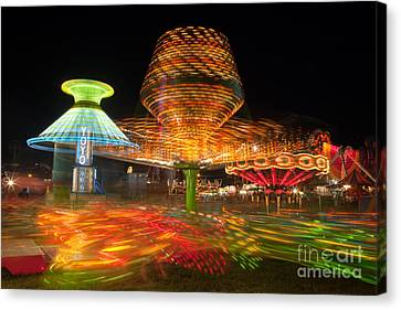 State Fair Rides At Night I Canvas Print by Clarence Holmes
