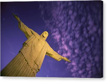 Statue Of Jesus Christ Against Twilight Canvas Print by Michael Melford
