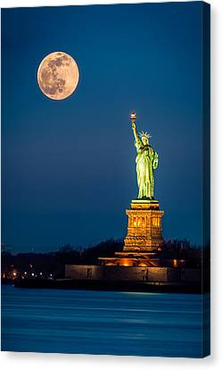Canvas Print featuring the photograph Statue Of Liberty And A Rising Supermoon In New York City by Mihai Andritoiu