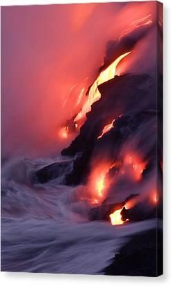 Steam Fills The Air As Water Meets Lava Canvas Print