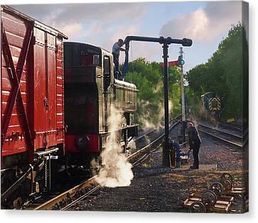 Steam Train Taking On Water Canvas Print by Gill Billington