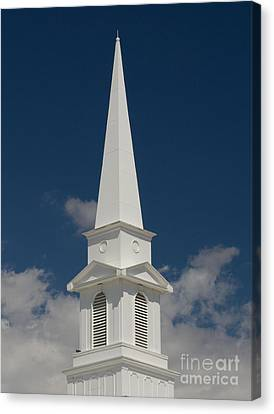 Steeple And Clouds Canvas Print by Merrimon Crawford