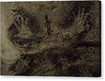 Stenciled Hands Over 10,000 Years-old Canvas Print by Carsten Peter