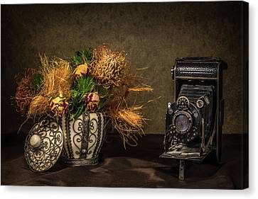 Still Life With Flowers And Camera Canvas Print by Wim Lanclus