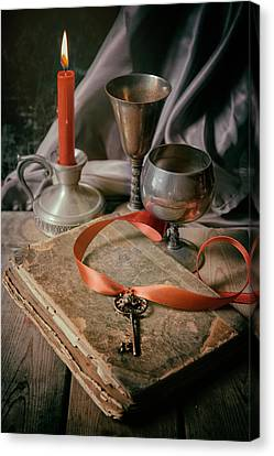 Canvas Print featuring the photograph Still Life With Old Book And Metal Dishes by Jaroslaw Blaminsky