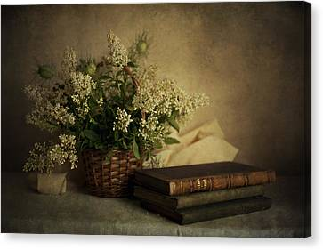 Still Life With Old Books And White Flowers In The Basket Canvas Print