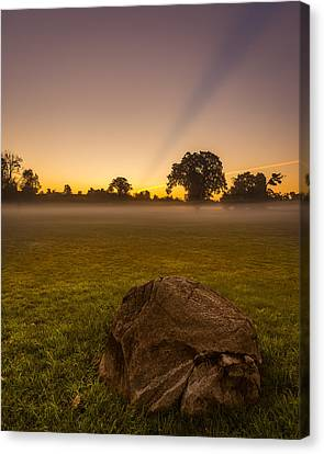 Stone Before A Misty Meadow Canvas Print by Chris Bordeleau