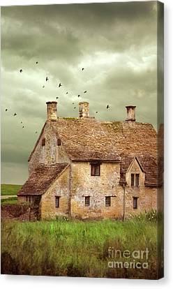 Stone Cottage And Stormy Sky Canvas Print by Jill Battaglia