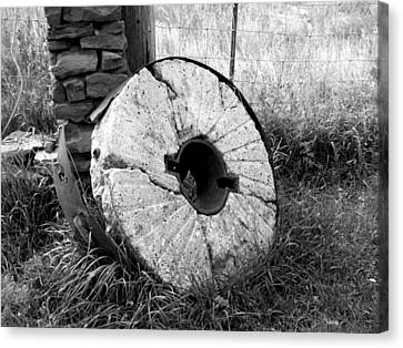 The Old Stone Grinding Wheel Canvas Print