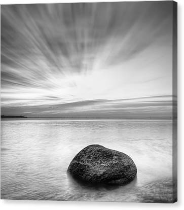 Stone In The Sea Canvas Print by Evgeni Dinev
