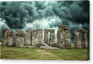 Stonehenge Storms Canvas Print by Martin Newman