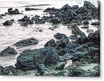 Stones On The Beach Canvas Print by Angel Jesus De la Fuente