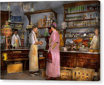 Store - In A General Store 1917 Canvas Print by Mike Savad