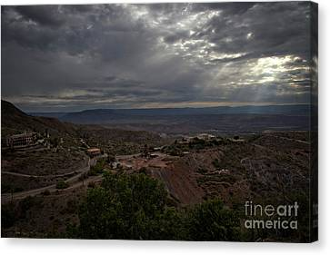 Canvas Print featuring the photograph Storm Clouds And Suns Rays Jerome Az by Ron Chilston
