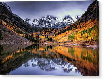 Storm Clouds Over Maroon Bells Canvas Print by Andrew Soundarajan