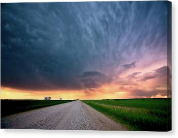 Storm Clouds Over Saskatchewan Country Road Canvas Print by Mark Duffy