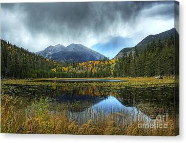 Storm Over Cub Lake Canvas Print by Pete Hellmann