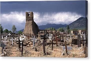 Pueblo Architecture Canvas Print - Storm Over Taos Graveyard by Sandra Bronstein