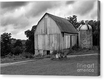 Stormy Barn Canvas Print by Perry Webster