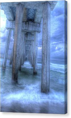 Stormy Pier 1 Canvas Print by Larry Underwood
