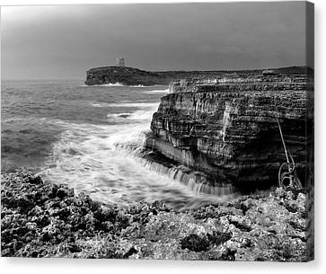Canvas Print featuring the photograph stormy sea - Slow waves in a rocky coast black and white photo by pedro cardona by Pedro Cardona