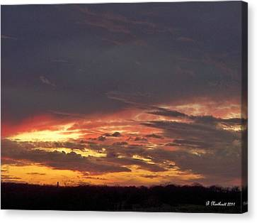 Stormy Sunset Canvas Print by Betty Northcutt