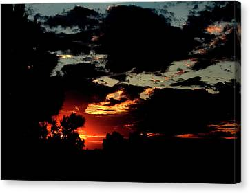 Stormy Sunset Canvas Print by Noel Hankamer