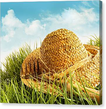 Straw Hat On Grass With Blue Sky  Canvas Print by Sandra Cunningham