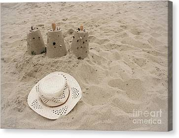 Straw Hat On The Beach Canvas Print by Colleen Kammerer