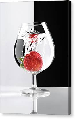 Strawberry In A Glass Canvas Print by Oleksiy Maksymenko