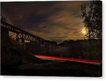 Strawberry Moon With Tail Light Streaks  Canvas Print by Joe Granita