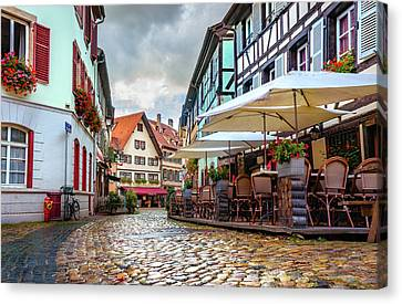 Canvas Print featuring the photograph Street Cafe After The Rain by Dmytro Korol