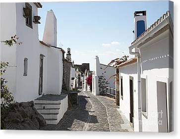 Street With White Houses Monsaraz Canvas Print by Compuinfoto