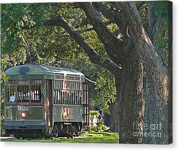 Streetcar Under The Oak Trees Canvas Print by Jeanne  Woods
