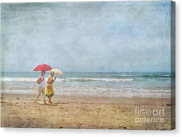 Canvas Print featuring the photograph Strolling On The Beach by David Zanzinger