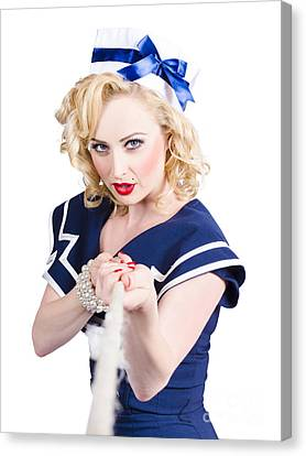 Strong Sailor Pin-up Model Pulling On Tough Rope Canvas Print by Jorgo Photography - Wall Art Gallery