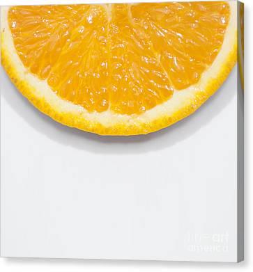 Orange Colors Canvas Print - Summer Fruit Orange Slice On Studio Copyspace by Jorgo Photography - Wall Art Gallery