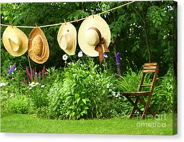 Summer Straw Hats Hanging On Clothesline Canvas Print by Sandra Cunningham