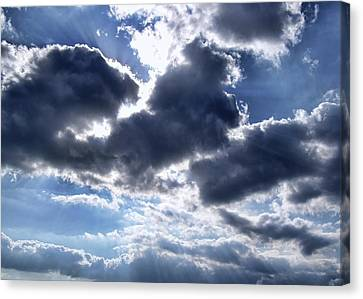 Sun Breaking Through The Clouds Canvas Print by Mariola Bitner