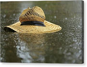 Sun Hat In The Rain Canvas Print