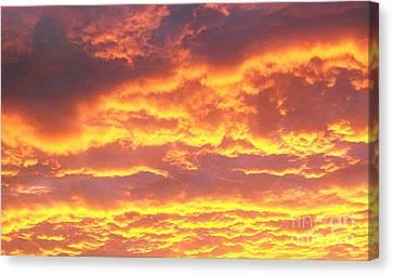 Sun On The Clouds Canvas Print by Marsha Heiken