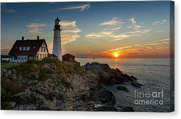 Rocky Maine Coast Canvas Print - Sun Rising At Portland Head Light by Jerry Fornarotto