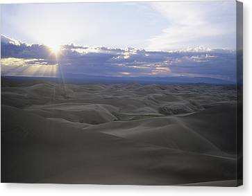 Sun Sets Over Miles Of Sand Dunes Canvas Print by Taylor S. Kennedy