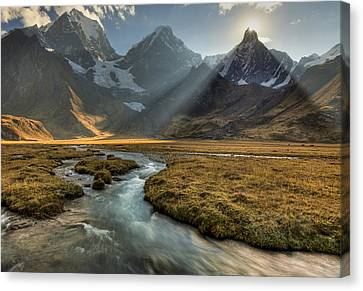 Sun Setting  Behind Jirishanca Peak Canvas Print by Colin Monteath