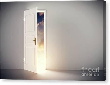 Sun Shining Through Half Open Classic White Door. Canvas Print by Michal Bednarek