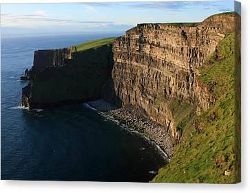 Sunlight On The Cliffs Canvas Print by Aidan Moran