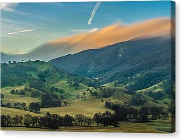 Sunlit Clouds On A Ridge Canvas Print by Marc Crumpler
