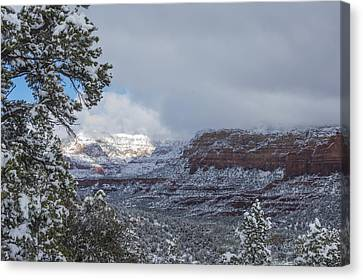 Canvas Print featuring the photograph Sunlit Snowy Cliff by Laura Pratt