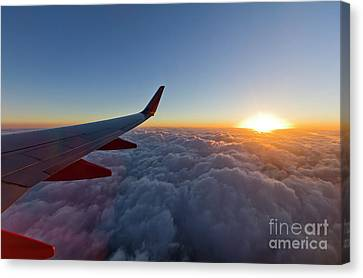 Sunrise Above The Clouds On Southwest Airlines Canvas Print by Dustin K Ryan