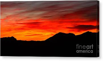 Sunrise Against Mountain Skyline Canvas Print by Max Allen